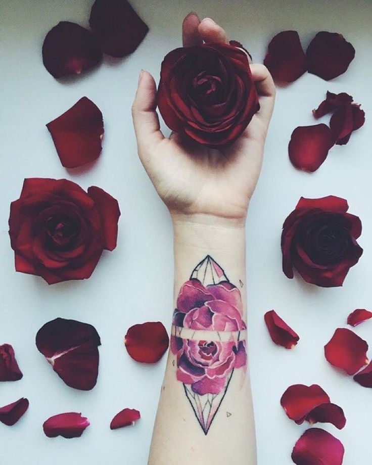 Rose tattoos, surrounded by roses. #ColoredTattoos #Tattoos #rose