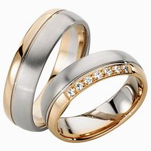 Furrer-Jacot Two-Tone Wedding Ring: Engineered for simplicity, this gorgeous two-tone wedding ring will last a lifetime. This band comes in 6mm width and is made in both men's and women's with a diamond styles.