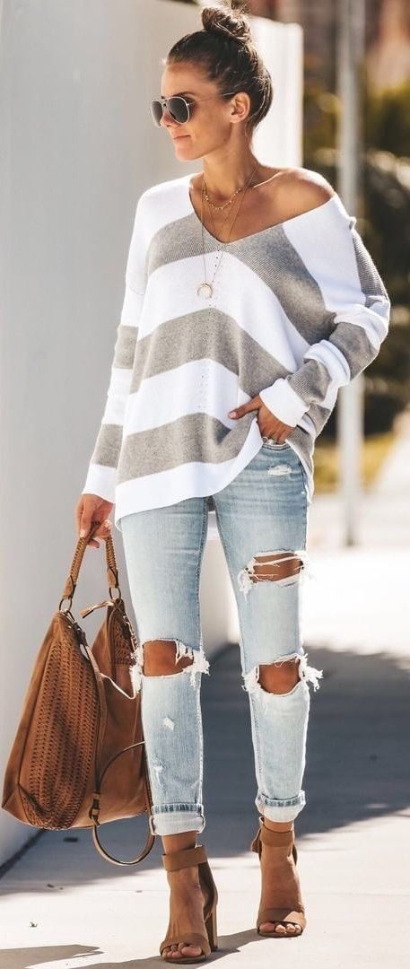 Comfy striped casual top with trendy ripped denim jeans. 1