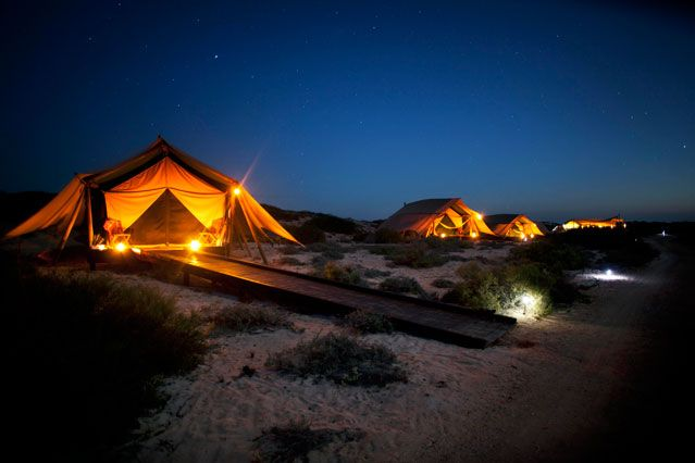 Top 10 Beachfront Bungalows: Sal Salis Ningaloo Reef, Australia. Best for going beyond the back of beyond. Available activities include diving, deep-sea fishing, kayaking, stargazing or viewing nearby fossil formations and wildlife. This destination is great year-round, but we prefer visiting April through June.