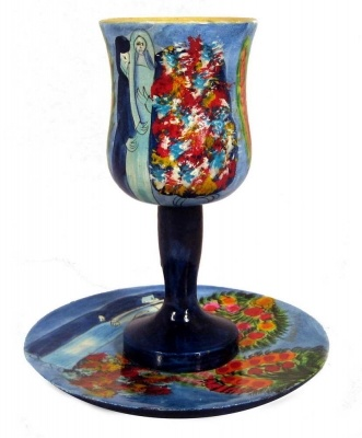One Of Two Wedding Kiddush Cups.  Hand Painted Wedding Kiddush Cup With Matching Coaster Plate. The Images Of A Bride And Groom With Colorful Flowers On This Wine Cup Will Make This Cup Perfect For Your Wedding.