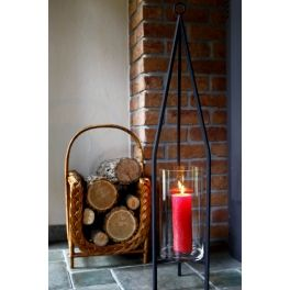 Metal lantern with three legs and a glass cylinder for placing a candle.