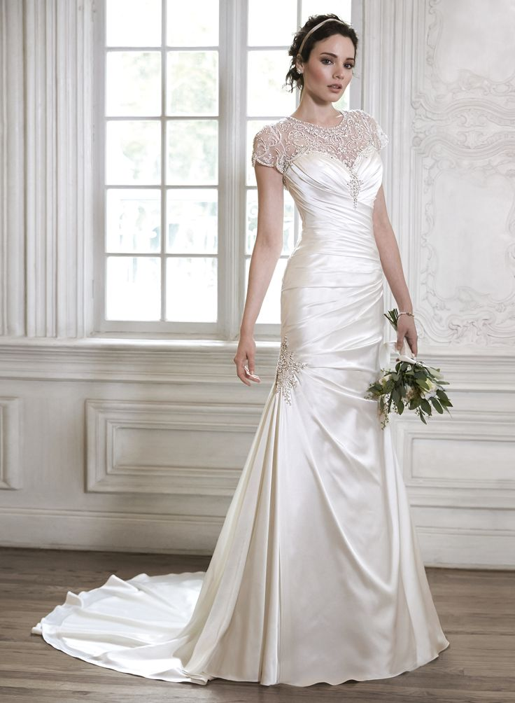 Trending Maggie Bridal by Maggie Sottero Stunning This dramatic and artful presentation of the illusion lace corset stops just short of the natural waist