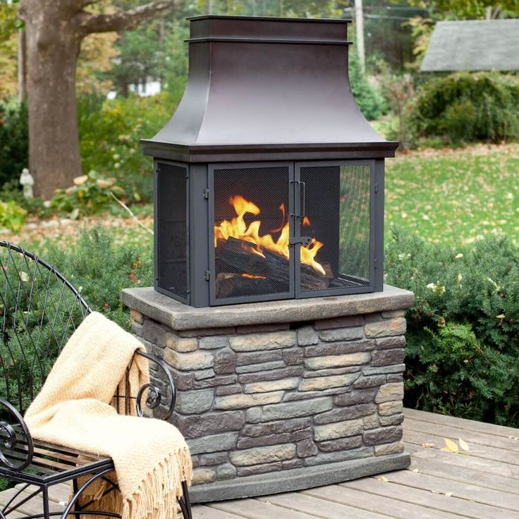 Exterior Design Small Functional Outdoor Wood Burning Fireplace Stacked On Natural Stones And Funnel On