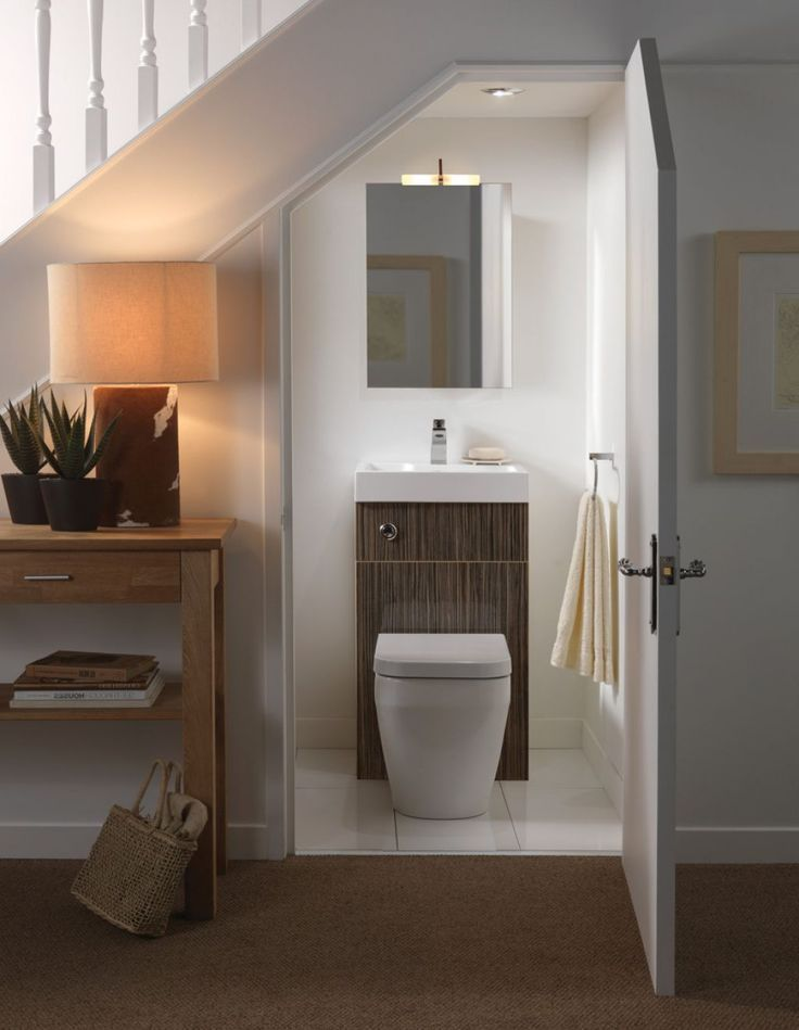 Inspiration and ideas for a tiny downstairs loo tucked under the stairs. Your cloakroom doesn't have to be boring!