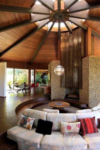 """Built-in seating surround the home's """"conversation pit."""""""