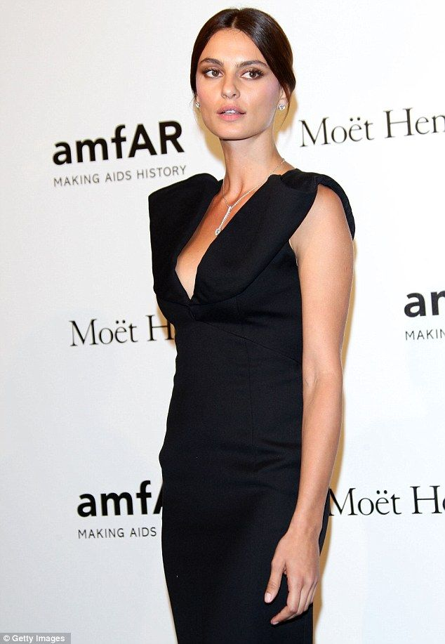 Black swan... Romanian model Catrinel Marlon wowed in a black gown as she pulled her hair back in one