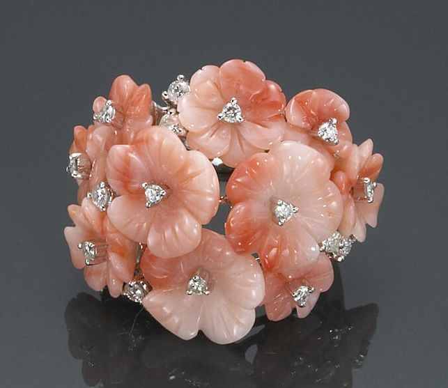 A coral and diamond floral ring.