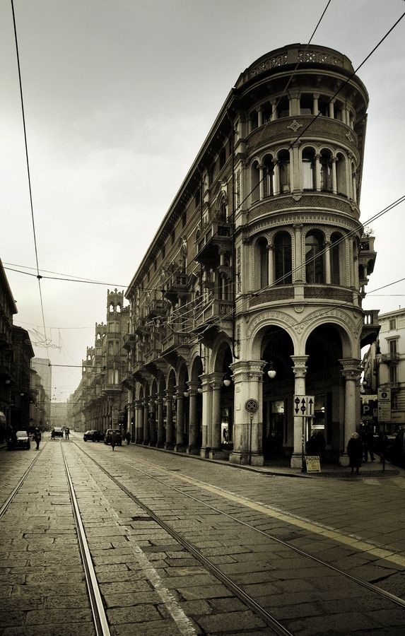 Turin (Italy) has miles of small shops and bars under arcades of late 19th and early 20th century buildings.