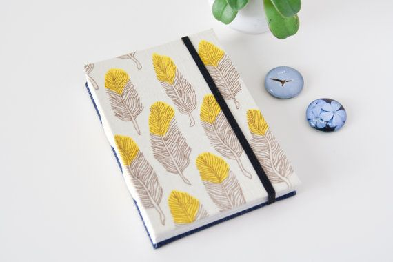 One of my most favourite items to take on a plane  - a nice fresh travel journal, ready for a new adventure in a far away land. This one has unlined pages so could be used as a sketchbook too.  Travel Journal with Unlined Pages. Feather Notebook. by Mettaville