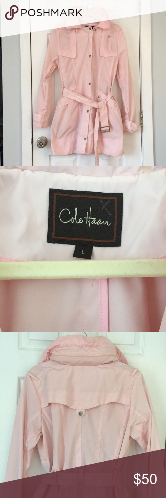 Cole Haan Rain Coat -Trench Light pink Cole Haan rain coat in a trench coat style. Very light weight and has a packable hood that can be rolled up into the collar. Size L, also has belt to cinch the waist in. Cole Haan Jackets & Coats Trench Coats