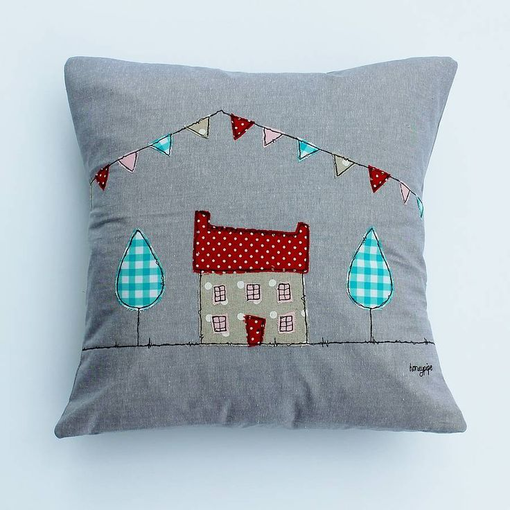 This beautiful cushion featuring a House and bunting design is made from a pretty cotton fabric.     This can be adapted to any colour scheme to suit your home, please contact Honeypips to discuss any requirements.The bunting has been appliqued and freehand machine embroidered which gives the edges a 'rough' look.  Made in an envelope style and finished and secured with ribbon and a vintage button, it comes complete with duck feather inner, for added plumpability.  Due to the handmade…