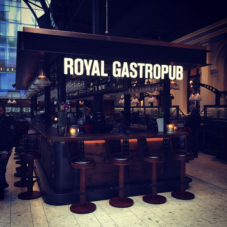 Sign for Royalgastropub inside the old railway station in Oslo Norway.