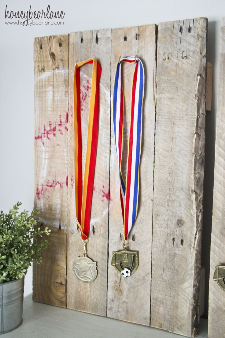 This pallet wood sports medal display fits perfectly into the rustic industrial decor planned for my boys bedroom.