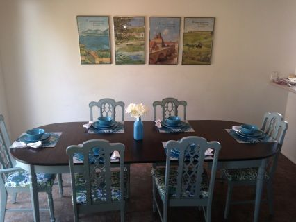 """Newly refinished pecan table and 6 chairs. Table top refinished with Java gel stain and polyed. Base of table and chairs painted with """"Persian Blue"""" milk paint and chairs recovered in """"Bombay Summer"""" fabric. Table has three leaves so it goes from 5 to 8 feet long, so it's highly versatile! Room for up ten when table is fully expanded."""