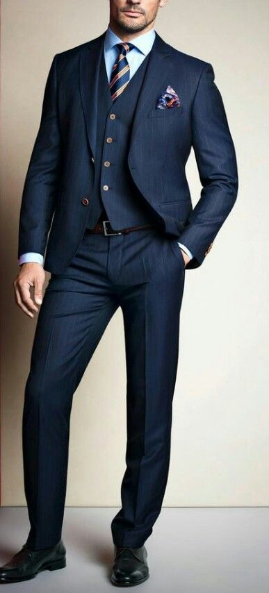 A must: a navy blue three pieces suit, striped tie, golden accents. #timeless #elegance #men