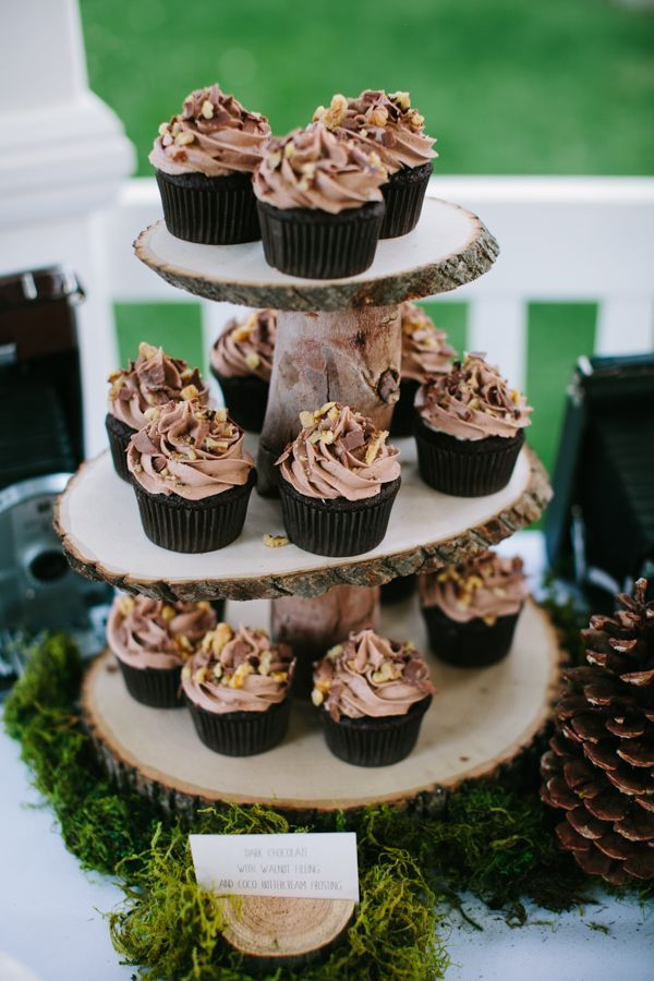 Woodland themed chocolate cupcake tower made of sliced wood #wedding #woodland #cupcaketower #weddingcupcake #rustic