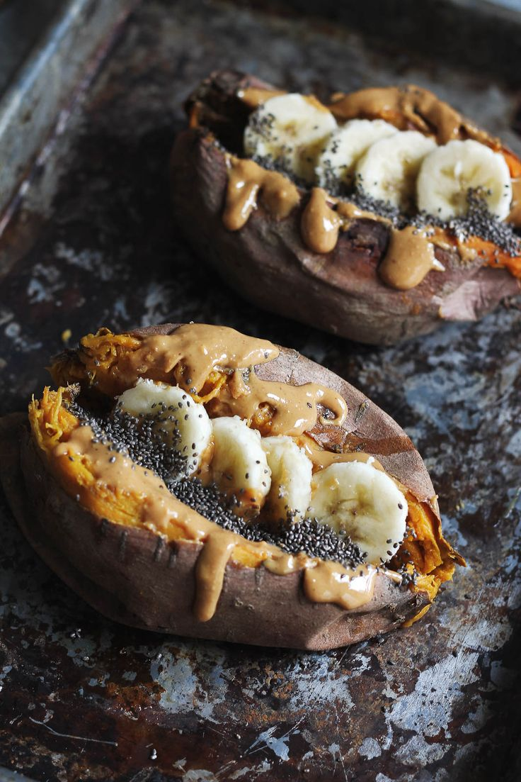 Breakfast baked sweet potatoes stuffed with creamy almond butter, and banana slices!