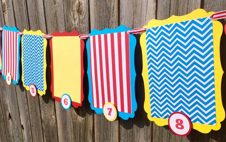 This colorful photo banner is perfect to display your child's monthly first year pictures on their special day. Each pennant is die cut for that unique circus inspired shape and is layered with patter