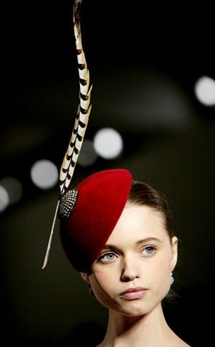 normally, I find these fascinators a bit goofy, but this one has style and it, well, fascinates me...