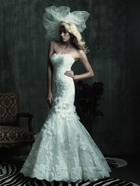 Delicate lace makes this gown absolutely stunning.    Free Shipping, No Tax and up to 400.00 dollars worth of bridal accessories!  In stock, call us today :1-877-731-8588 www.madamebridal.com