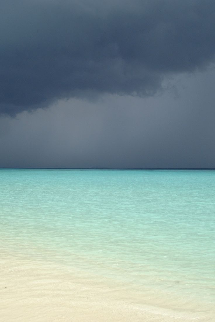 Not even a stormy sky can darken the waters in The Maldives. #corona #coronaextra #theplacetobe