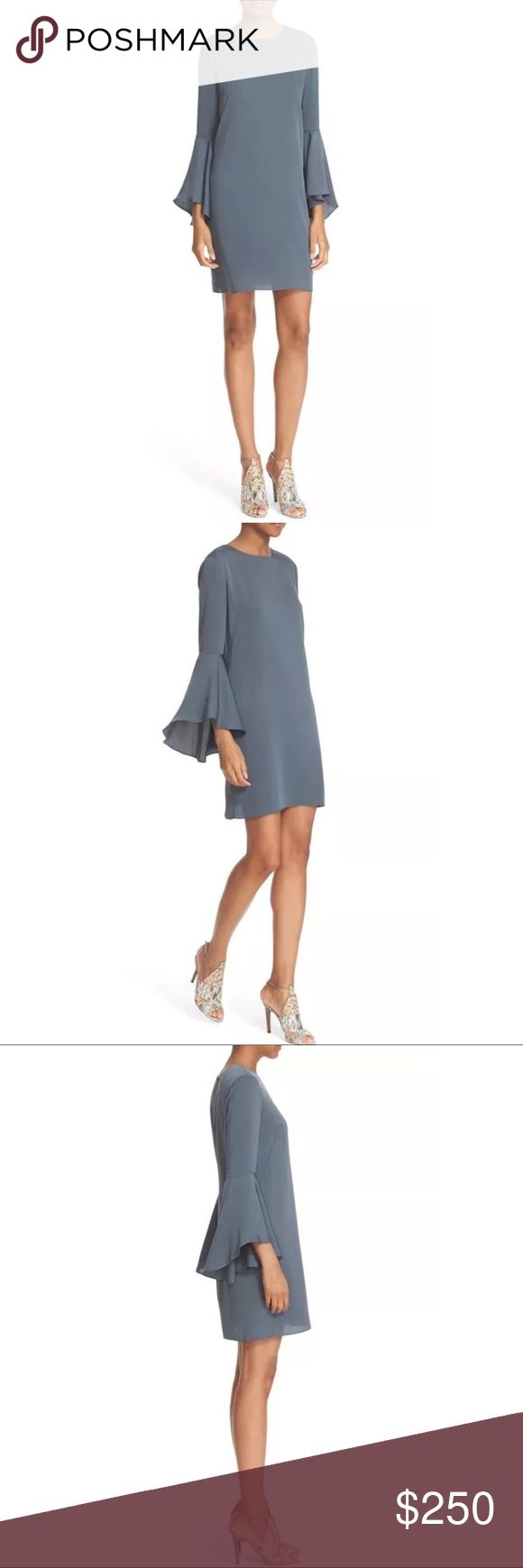 MILLY 10 Grey Silk Bell Sleeve Crepe Shift Dress Retail $425 NWT. Price Firm.  Flowy bell sleeves bring charming flutter to a figure-skimming shift fashioned from soft, stretch-woven silk. Hidden back zip with button-loop keyhole closure. Jewel neck. Three-quarter bell sleeves. Lined. 92% silk, 8% elastane. Dry clean. By Milly; imported. Individualist. Item #5217108 Measurements according to brand: Bust 37 Waist 29 Hips 39.  #0128 Milly Dresses