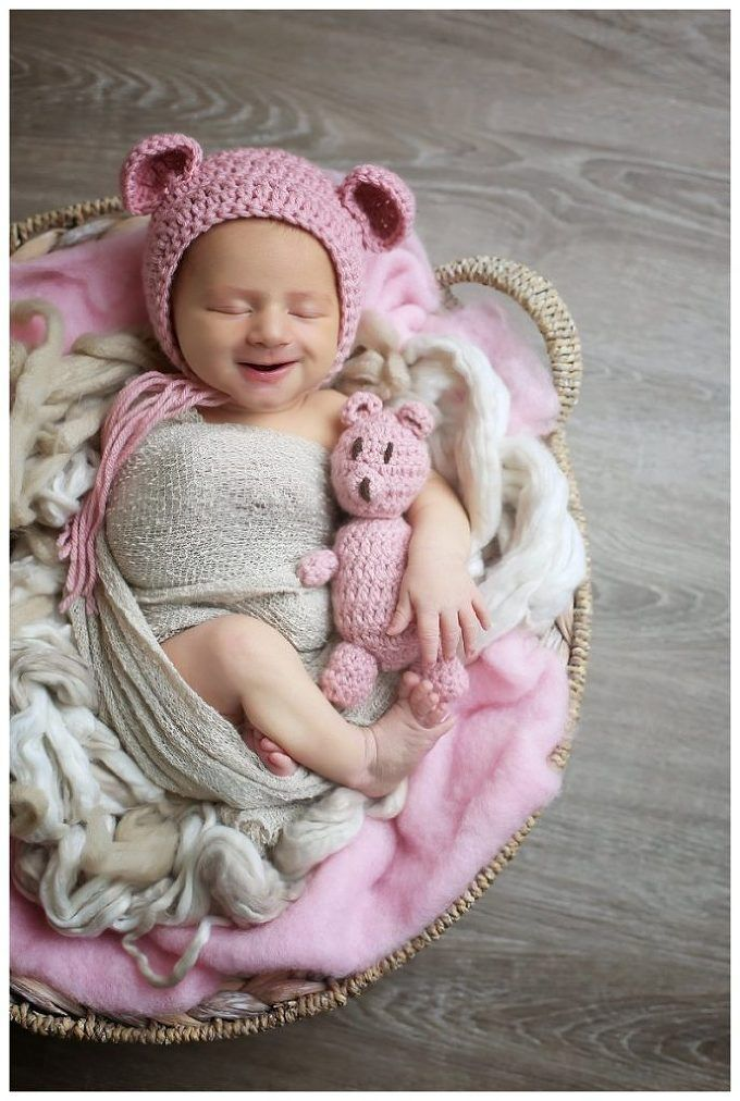 Annapolis Newborn Photographer , baby smiles, baby with pink bear, baby in knit hat