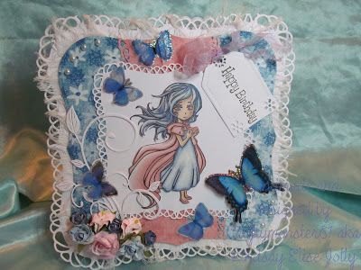For Today's card I made the card base with the new Spellbinders Decorative Grand Dies, the papers are from K and Melody Ross and I used a woodware edge punch on the pink paper and then layered them on to frayed muslin. The image I used is a stamp from Visible Image coloured with Promarkers, the tag is a die from Marianne Design and the flourish is a die from Cheery Lynn. I have then decorated with pearls, ribbon, flowers and butterflies.