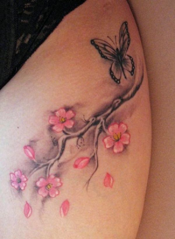 Simple and cute cherry blossom tattoo with a butterfly. This almost minimalist design is very simple yet eye catching because of its simplicity.