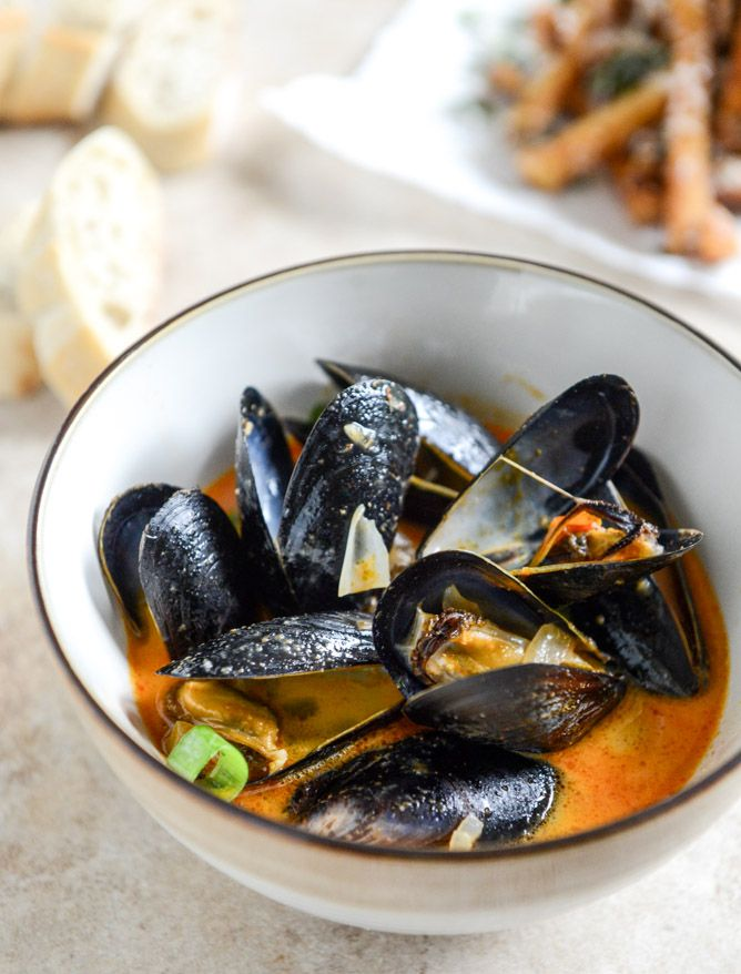 Add some coconut flavor and a dash of curry to your mussels for this mouth-watering side dish. | seafood appetizer