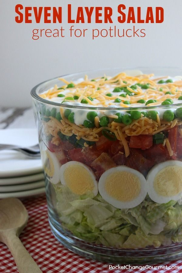 Heading to a potluck? Hosting a cookout? This Classic Seven Layer Salad Recipe is a MUST make! A crowd-pleaser for sure! It's super easy to make, can be made ahead and feeds a crowd!
