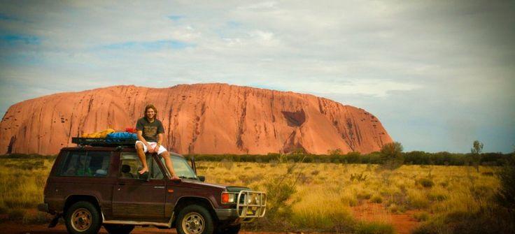 Car in front of Uluru