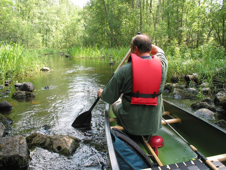 Canoeing in the clear waters of Lake Saimaa