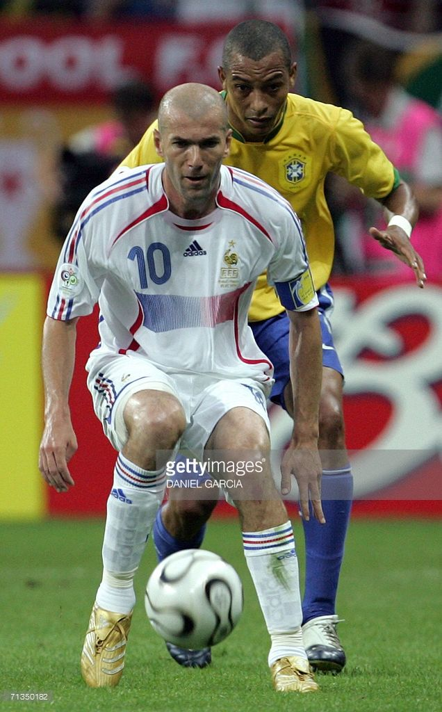 French midfielder Zinedine Zidane (front) is challenged by Brazilian midfielder Gilberto Silva (behind) during the quarter-final World Cup football match between Brazil and France at Frankfurt's World Cup Stadium, 01 July 2006. The match was scoreless at half-time.