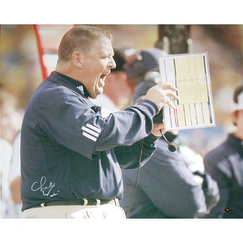 Charlie Weis Yelling from Sidelines 16x20 Photo - Charlie Weis a 1978 University of Notre Dame graduate and owner of four Super Bowl champion rings as products of a stellar 15-season career as a National Football League assistant was named the 28th head football coach of the Fighting Irish in 2004. Weis became the first Notre Dame graduate to serve as the Irish football coach on a full-fledged basis since Joe Kuharich a 38 Notre Dame graduate who coached at Notre Dame from 1959 through 62…