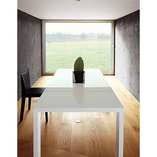 Glass and metal extending table. Products available through Selene. www.selenefurniture.com
