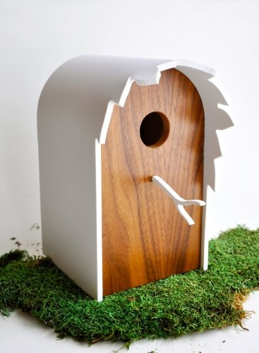 MODERN WALNUT BIRDHOUSE - 'CANOPY' SERIES  Made with walnut veneered birch plywood and a leaf 'canopy' roof of lightweight polyvinyl, which is dent & scratch resistant. Made for small birds such as Tree Swallows, Bluebirds and Wrens. Rear 'worm' shaped circulation vents and a graphic white twig perch provide whimsical (and practical) finishing touches.     Material(s): Walnut veneered birch ply, lightweight polyvinyl  Price: 98.00  Artist : Patrick LaJoie