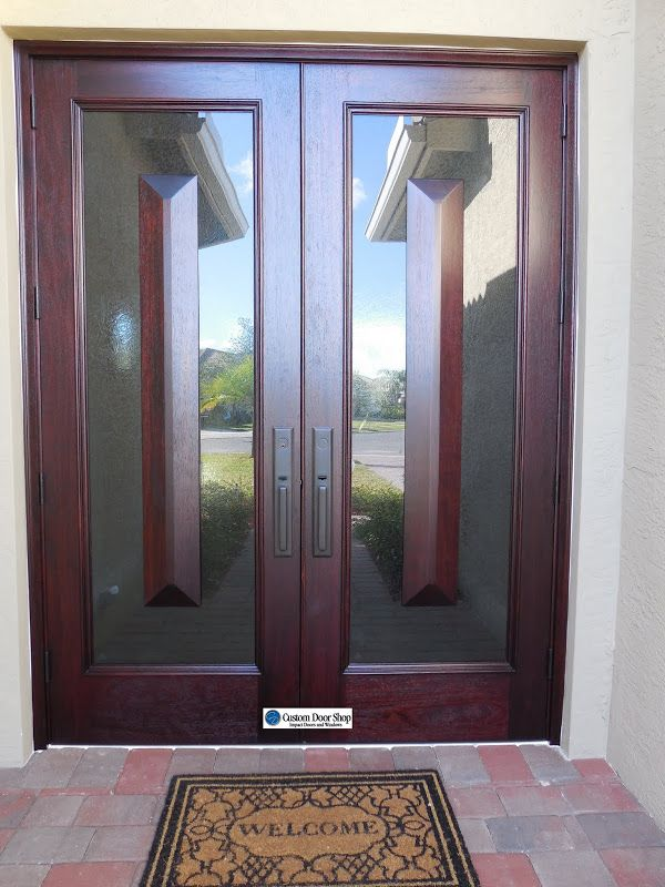 Unique custom front doors! Double mahogany wood doors with glass and floating pyramid panels.