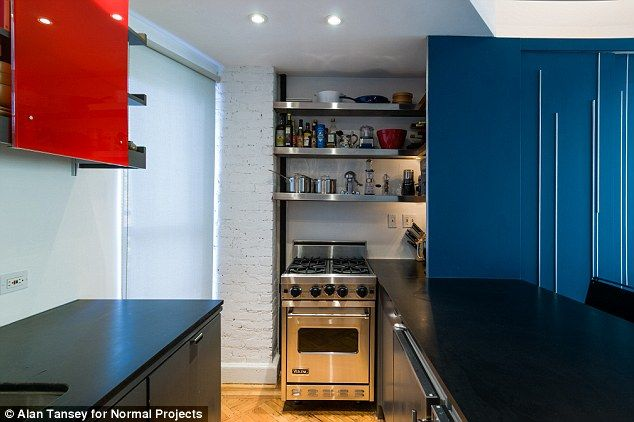 Gourmet kitchen: The miniscule apartment features an under-the-counter fridge and a half-width gas range