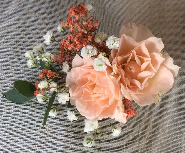 Peach and salmon corsage on a magnet by Cathey's flowers