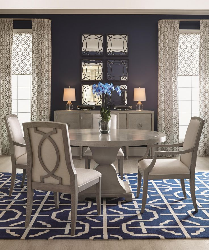 Create a dining space that exudes luxury and sophistication with this round dining set.