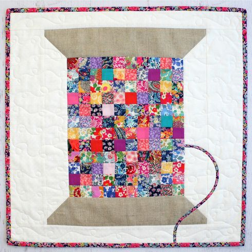 Liberty Vintage Cotton Reel Mini Quilt pattern. By Jemima Flendt, Tied with a Ribbon