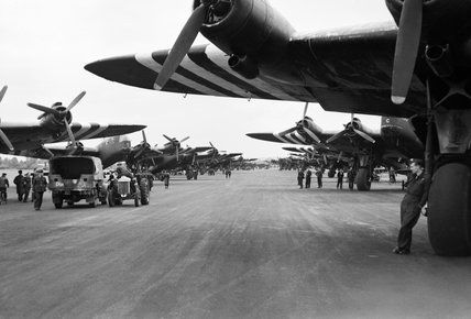 Short Stirling Mk IVs of Nos. 196 and 299 Squadrons RAF lining the runway at Keevil in Wiltshire, 5th June 1944