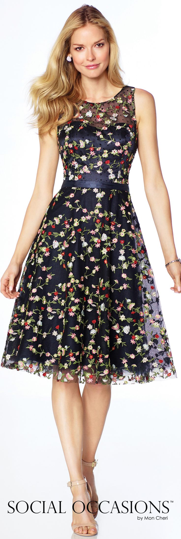 Social Occasions by Mon Cheri - 117824 - Sleeveless allover embroidered lace knee-length A-line dress with hand-beaded illusion jewel neckline and sweetheart bodice, beaded illusion back, satin belt at natural waistline.Sizes: 4 – 20Colors: Navy Blue/Multi, Ivory/Multi