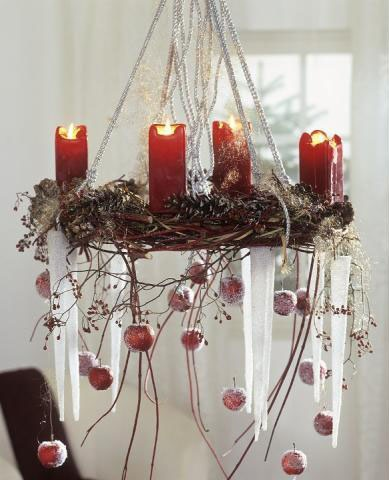 Pretty grapevine with red candles and trailing  ornaments. Horizontal hanging wreath.  Horizontally hung wreath.