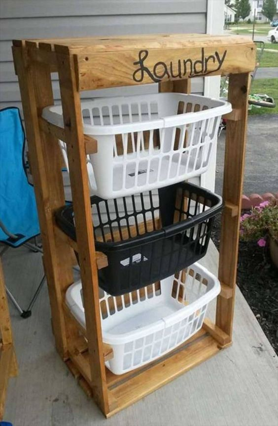 Turn Pallets into a Laundry Basket Holder...these are the BEST DIY Pallet Ideas!