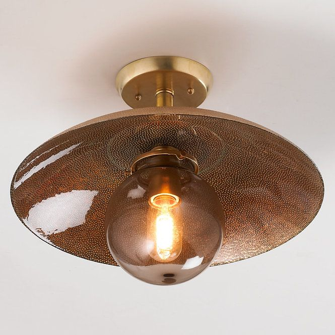 "A copper textured pebble glass shade covers a smoke glass globe top to create this spectacular Young House Love ceiling light. The top glass finish shines of copper and the interior shows off a little green as if the copper glass is starting to turn. The effect is stunning.40 watts max medium base socket.(12""Hx16""W)Supplied with 5"" round canopy."