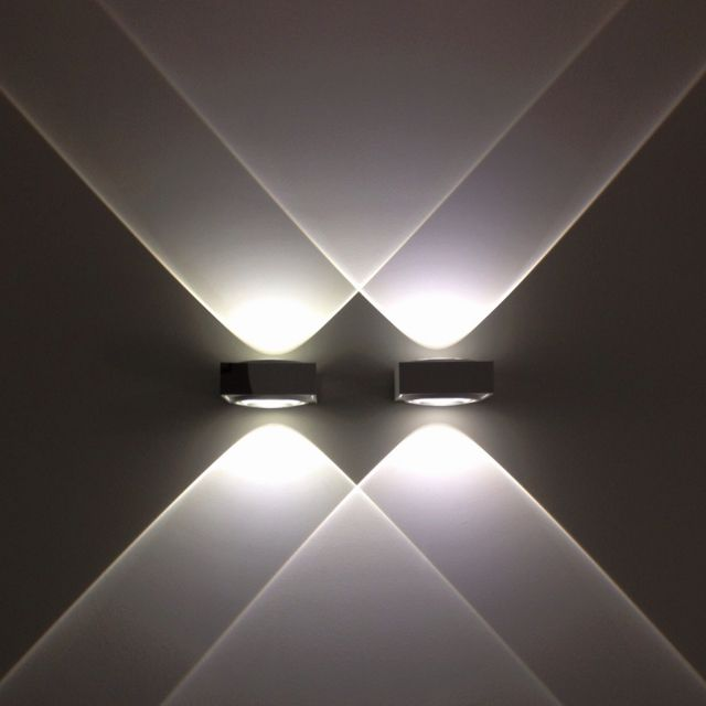 Wall Sconces ~ Double light ~ Love the light beam crossing over each other...the visual is fabulous!  Vision. Delta Light-2010