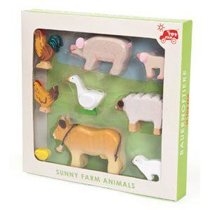 Assortiment de 9 animaux de la ferme en bois peint minutieusement décorés, présenté dans un coffret. Jouet pour enfant en bois